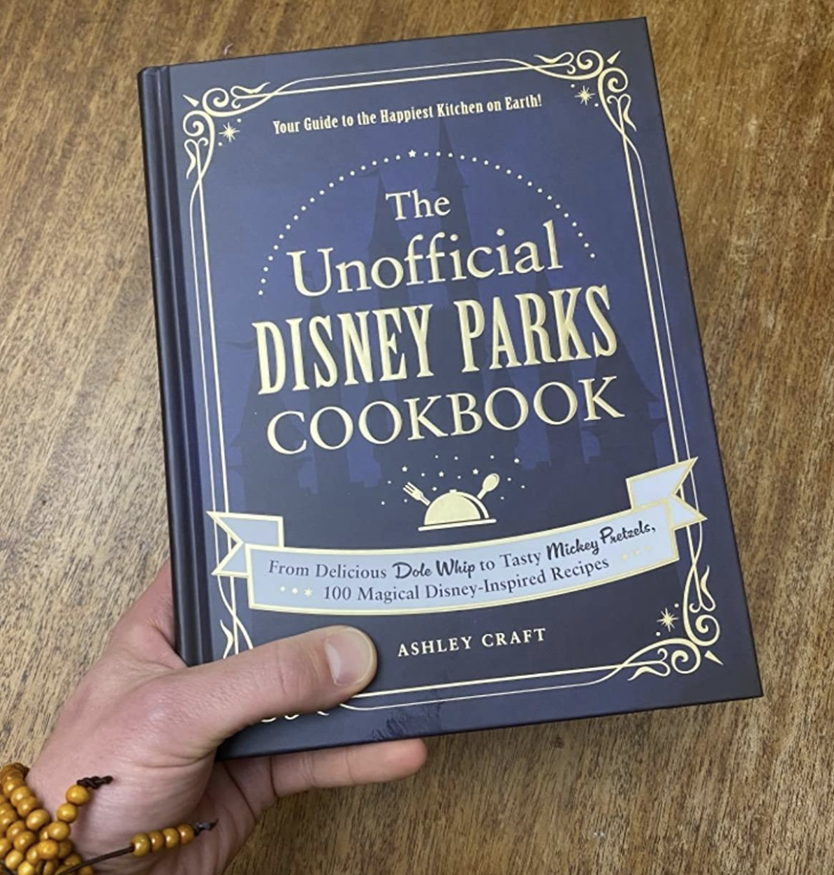 reviewer holding the cookbook