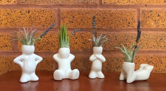 People-shaped planters in different sitting and standing positions