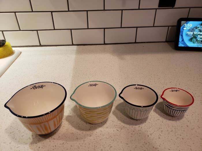 reviewer image of the four Creative Co-Op Hand Stamped Striped Stoneware Measuring Cups