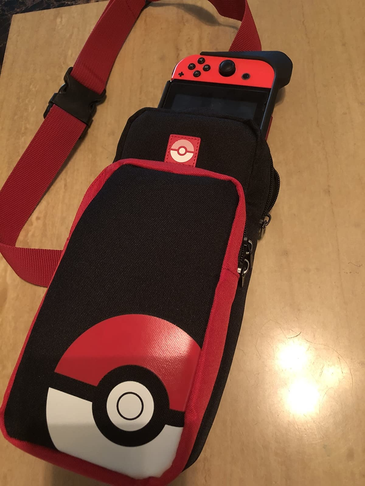 Reviewer photo showing Nintendo Switch inside of Pokémon-themed bag