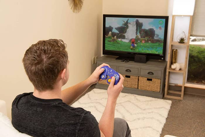Model using the controller to play Mario