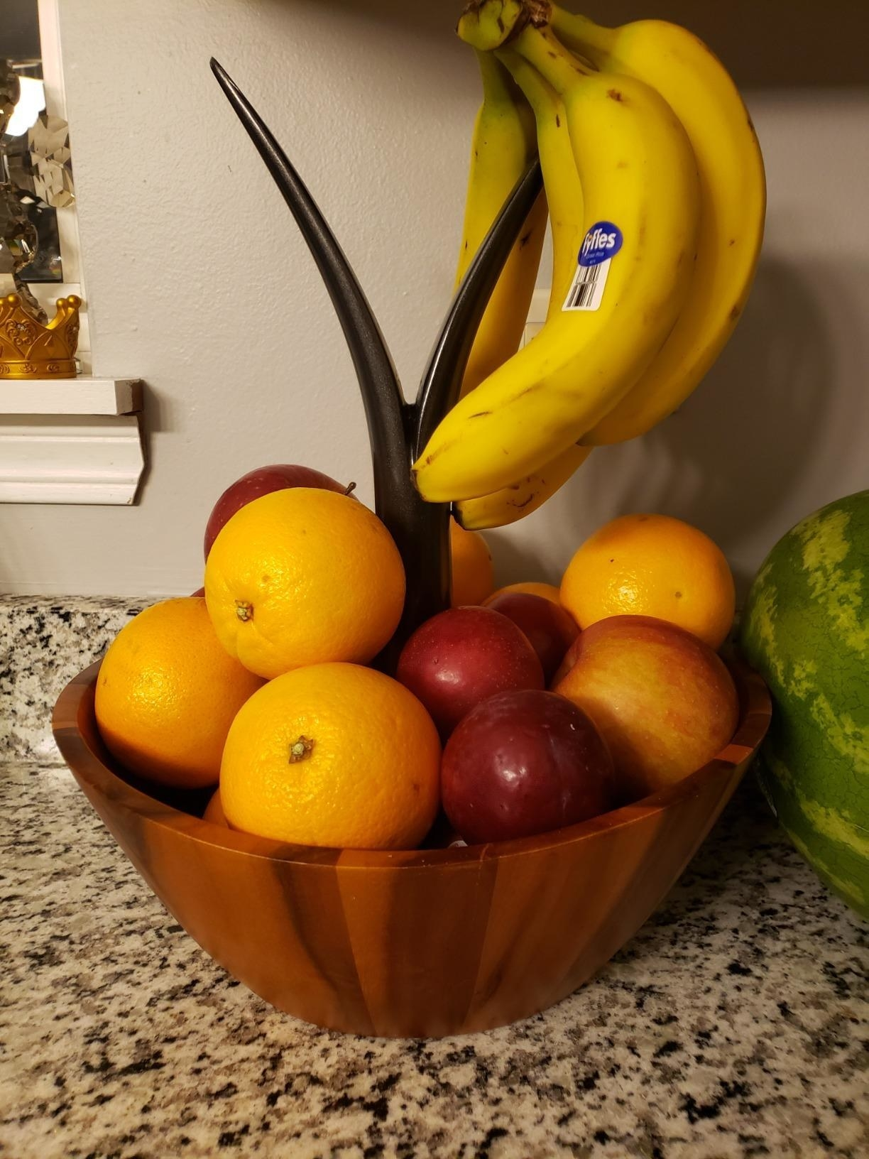 reviewer image of the casa bellante fruit bowl and hanger full of fruit on a customer's kitchen counter
