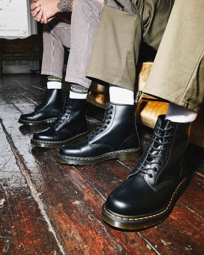 Two models wearing the 1460s in smooth black leather
