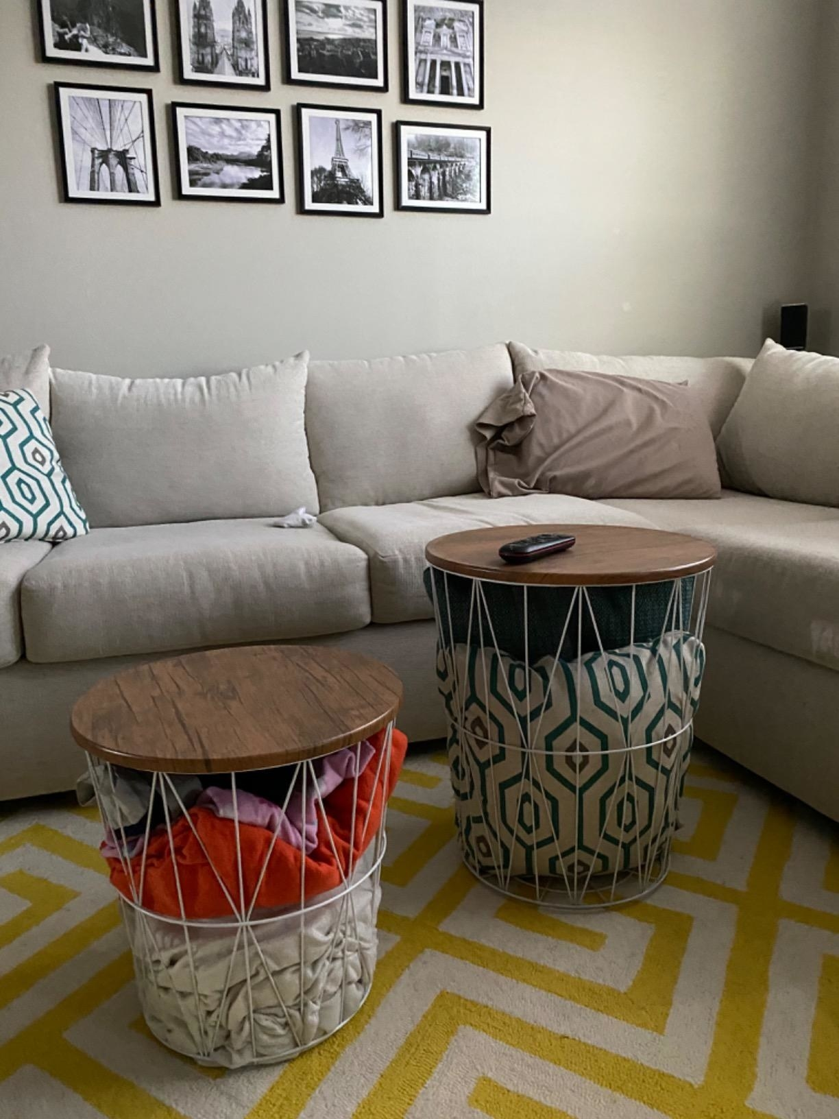 reviewer image of two Lavish Home Nesting End Tables with Storage in a customer's living room being used to store blankets and pillows