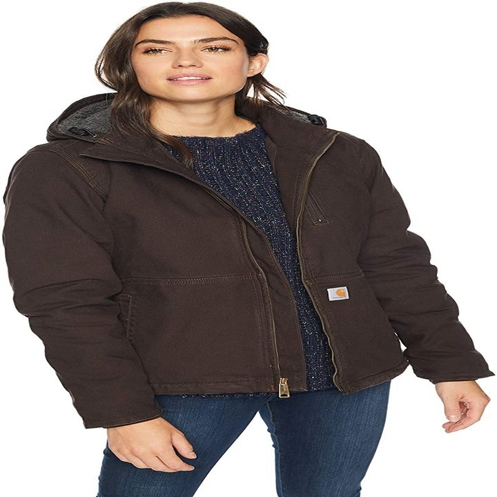 Front view of a model wearing the coat in dark brown
