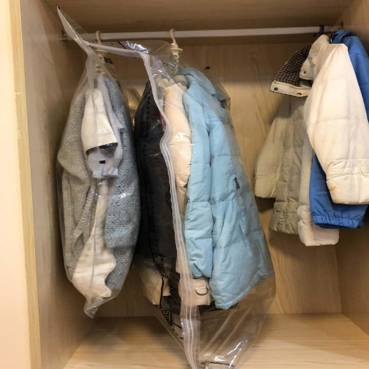 Reviewer photo of their clothes inside the bags