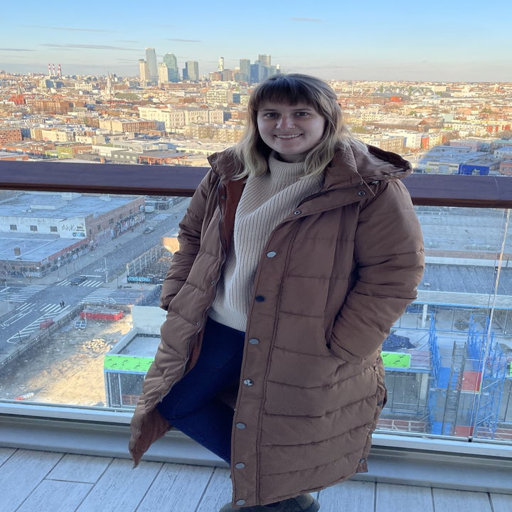 BuzzFeed editor wearing the coat in caramel