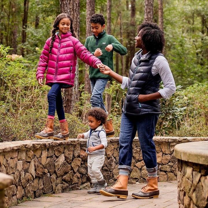 a family wearing ll bean duck boots