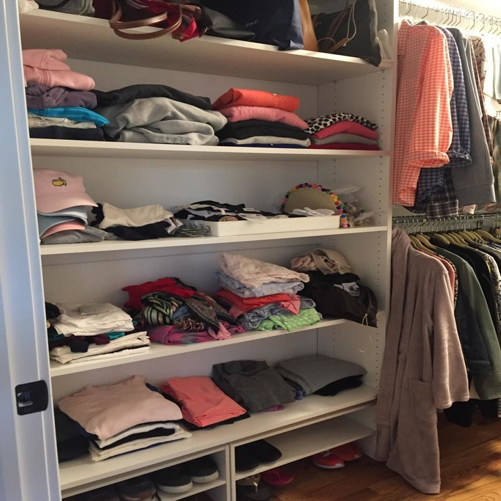 A closet of clothes that are neatly organized but kinda smushed together