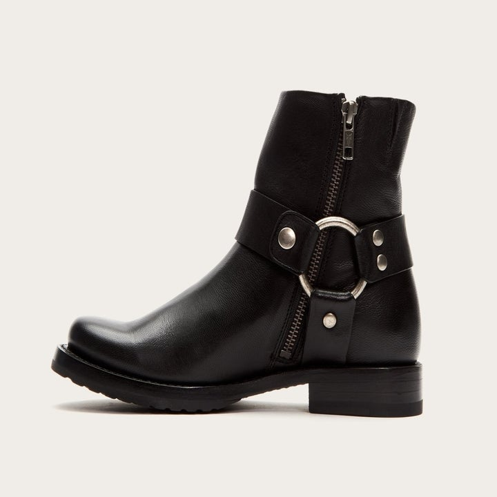 Left side view of the black leather boot which has an interior zipper