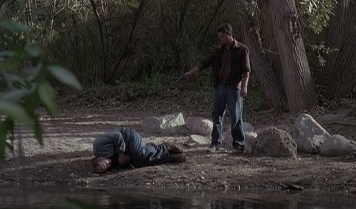 """Gary Sinise as George Milton and John Malkovich as Lennie Small in the movie """"Of Mice and Men."""""""