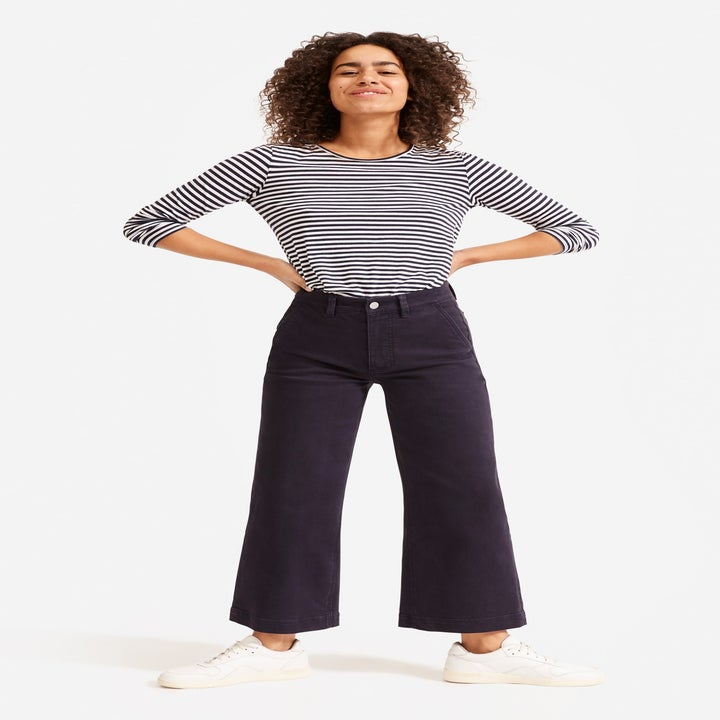 A model wearing the pants in navy blue