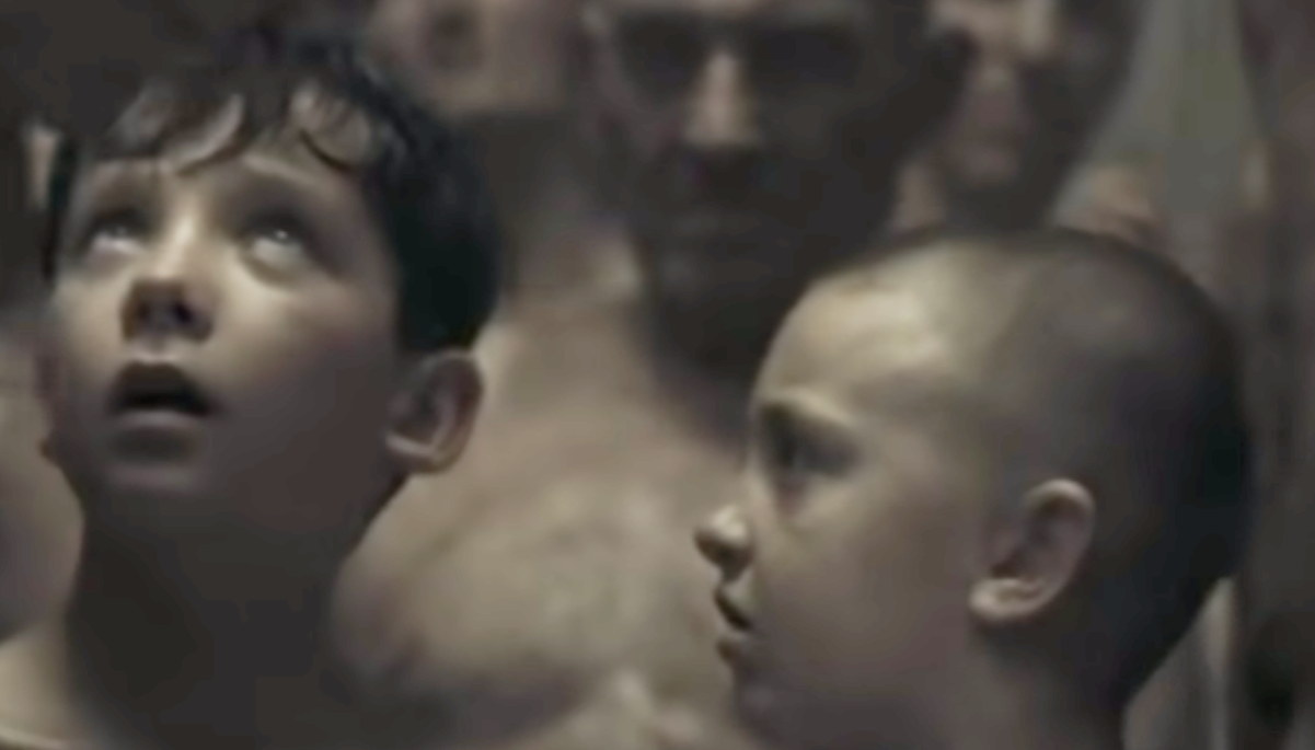 """Asa Butterfield as Bruno and Jack Scanlon as Shmuel in the movie """"The Boy in the Striped Pajamas."""""""