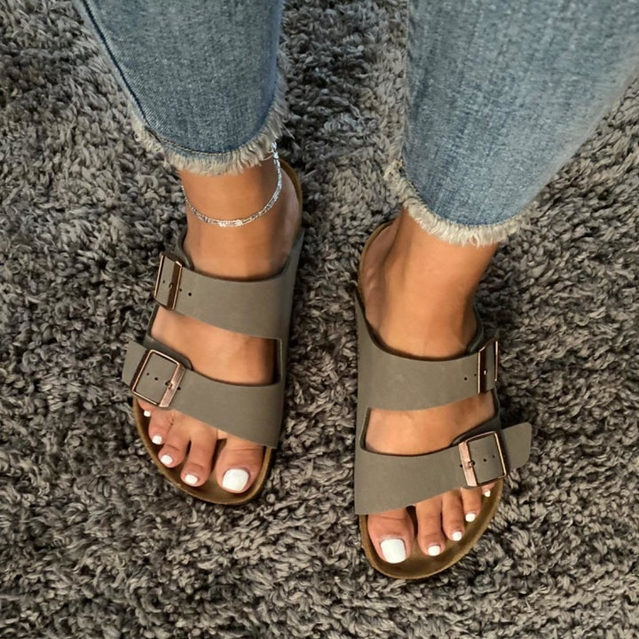 A reviewer wearing the sandals in stone biribuck