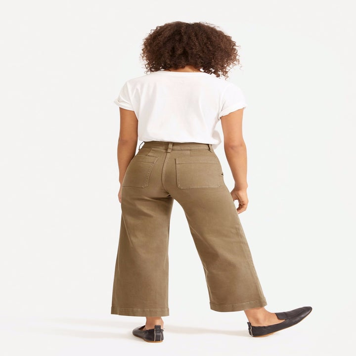 Back view of a model wearing the pants in ochre