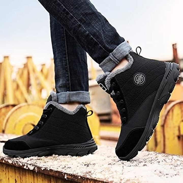 black short winter boots with gray fleece along the top