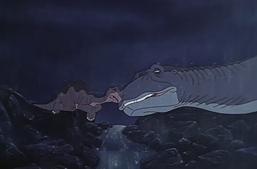 """Gabriel Damon as Littlefoot and Helen Shaver as Littlefoot's mother in the movie """"The Land Before Time."""""""