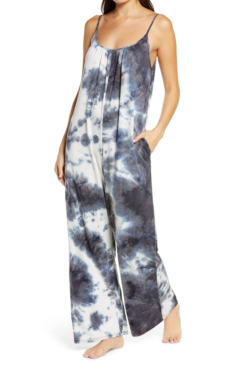 Model wearing the wide-leg spaghetti strap jumpsuit in black and white tie-dye pattern to it