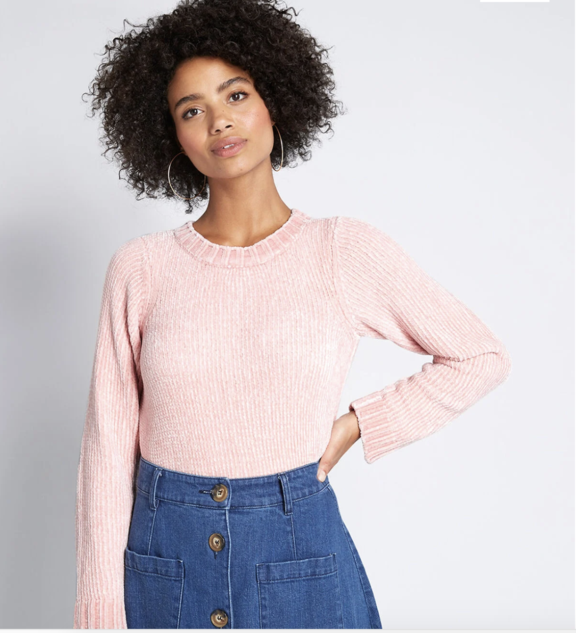 Model in ribbed blush pink chenille sweater