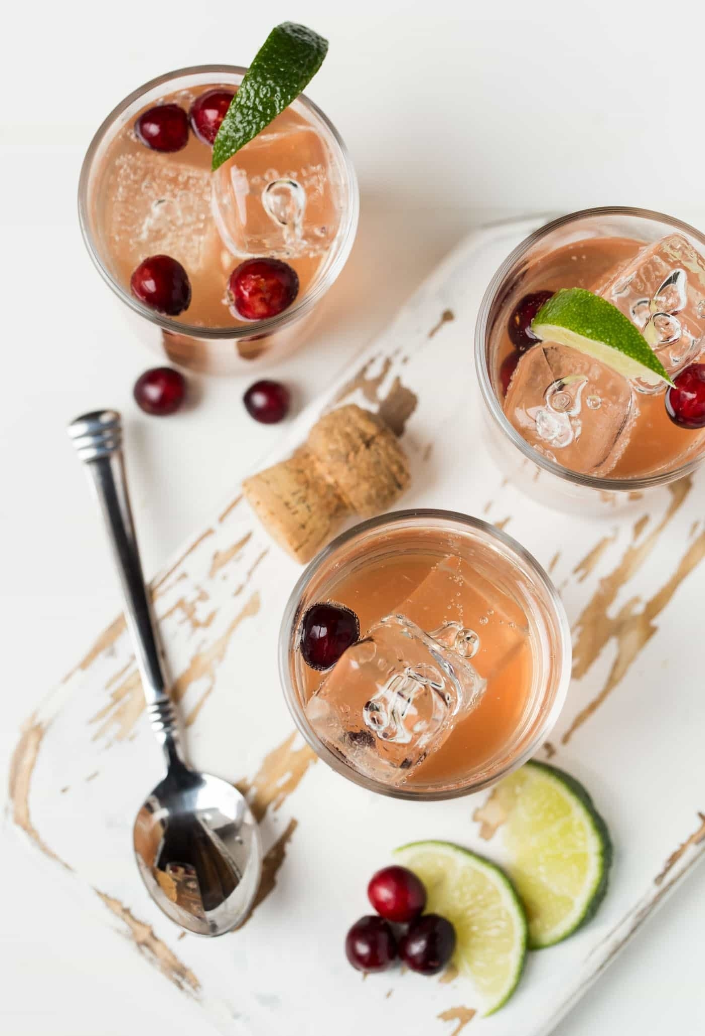Three glasses of sparkling cranberry gin cocktails.