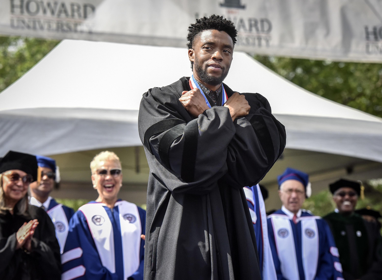 Chadwick giving the 'Wakanda Forever' salute at the Howard University graduation ceremony