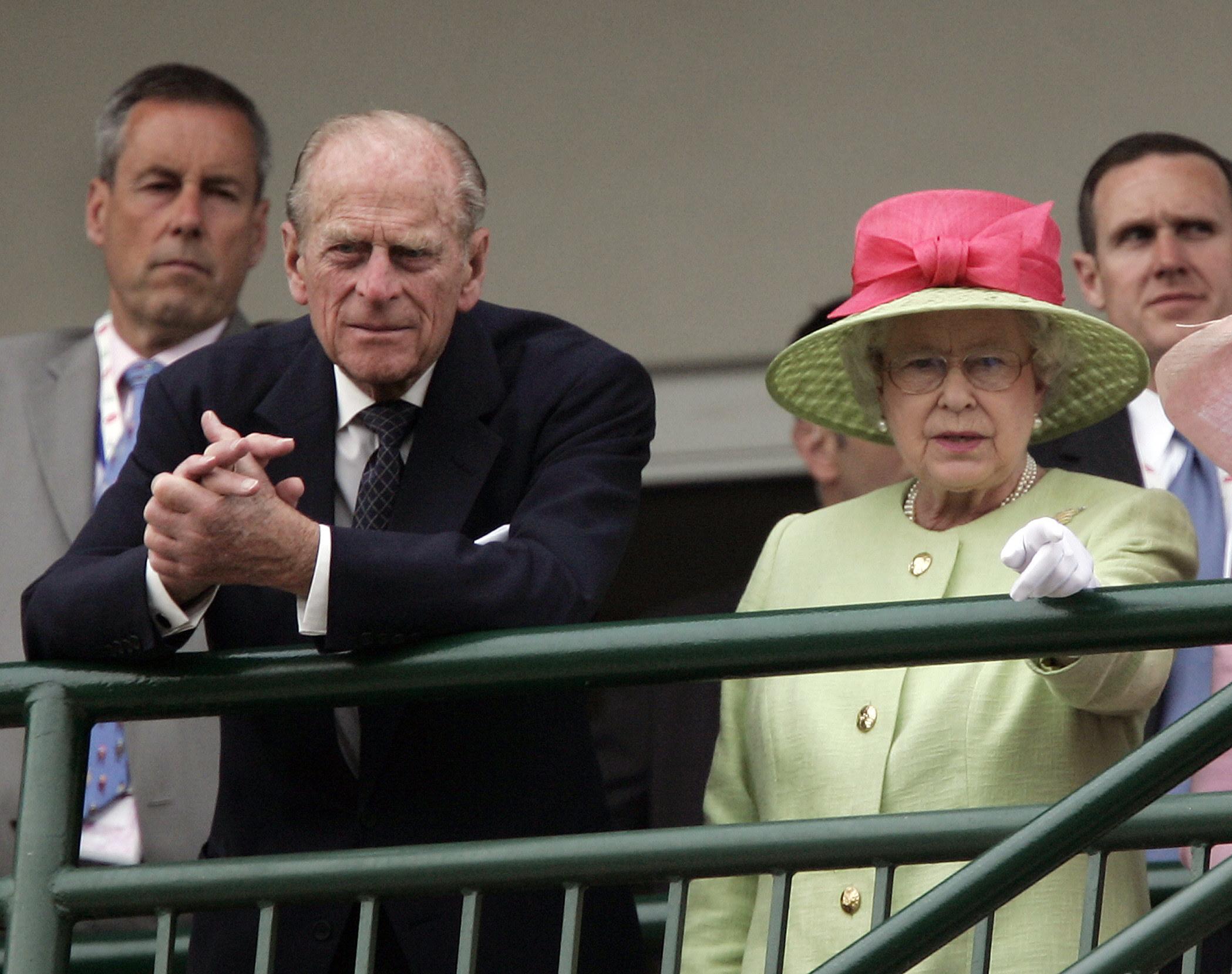 Prince Philip standing with Queen Elizabeth