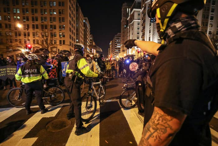 Protesters and police officers face off