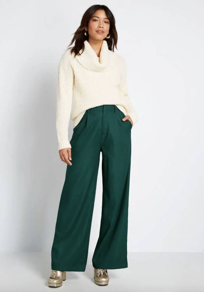 Model in flare leg hunter green pants