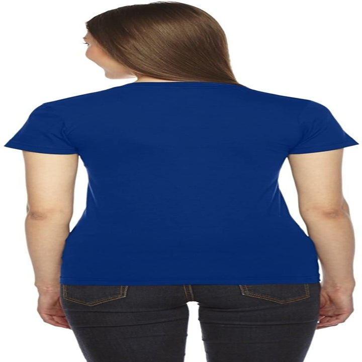 Back view of a model wearing the shirt in lapis