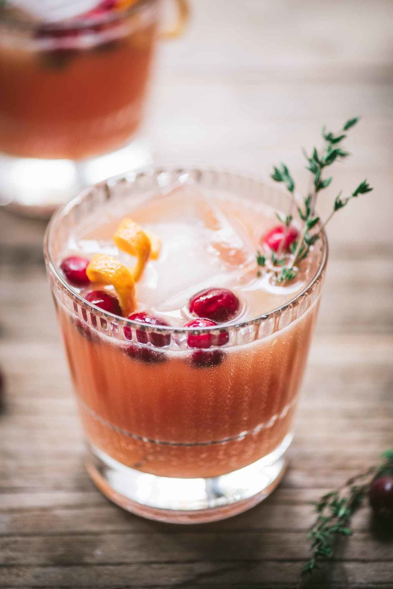 A cranberry orange whiskey cocktail.