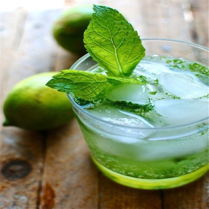 A mojito cocktail with fresh mint.