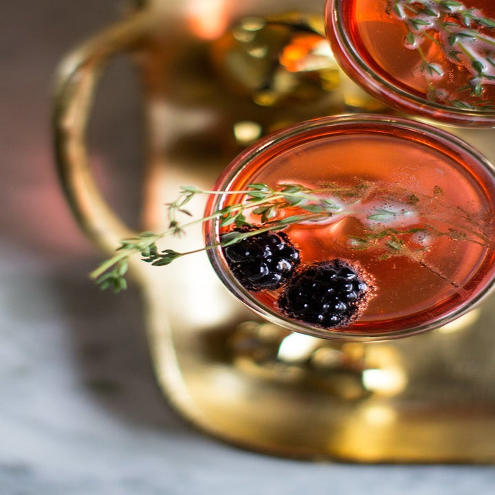 Blackberry thyme Champagne cocktails on a tray.