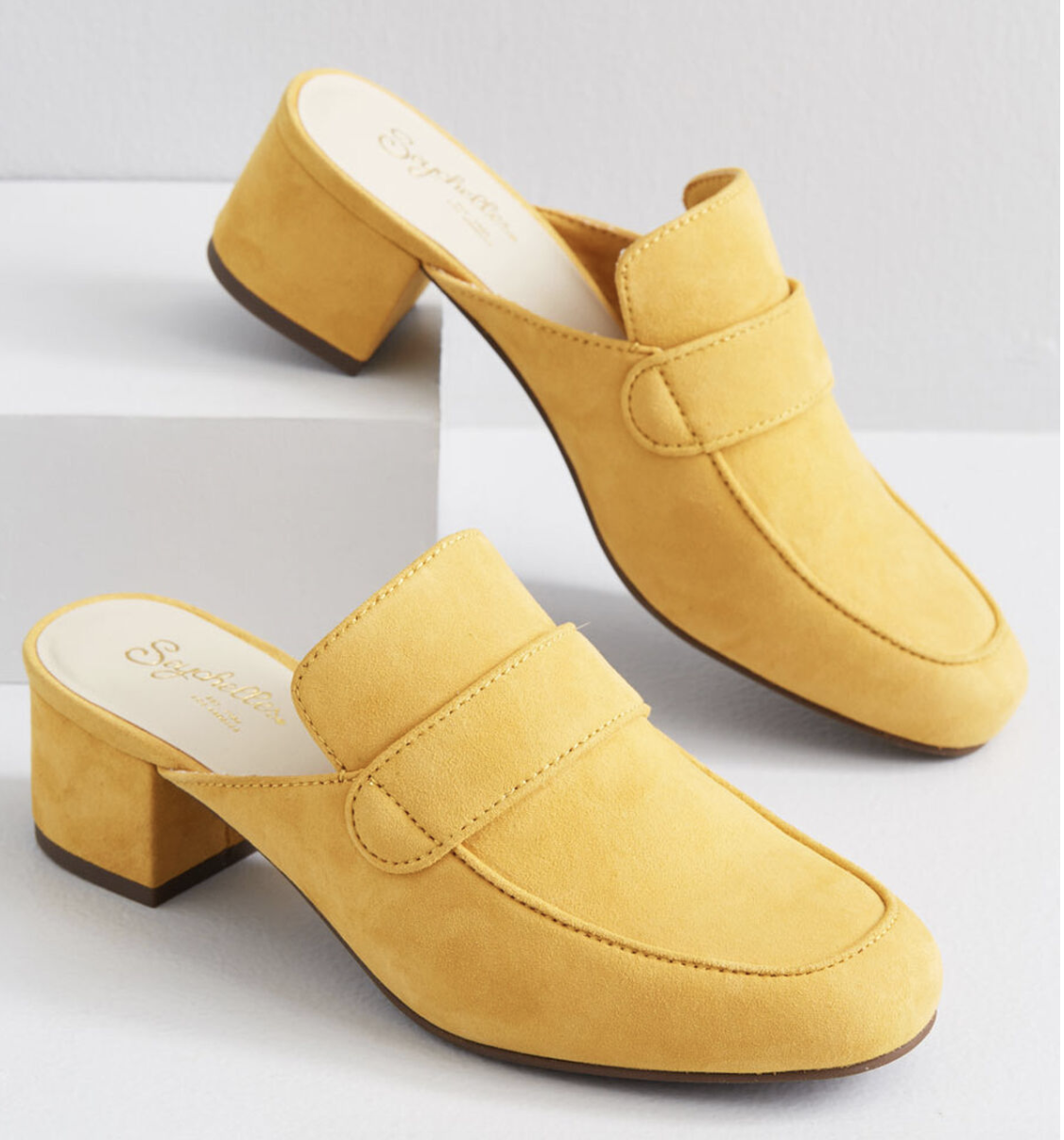 A pair of backless heeled yellow mules