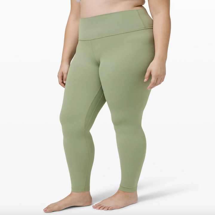 Front view of a model wearing the 28-inch leggings in willow green