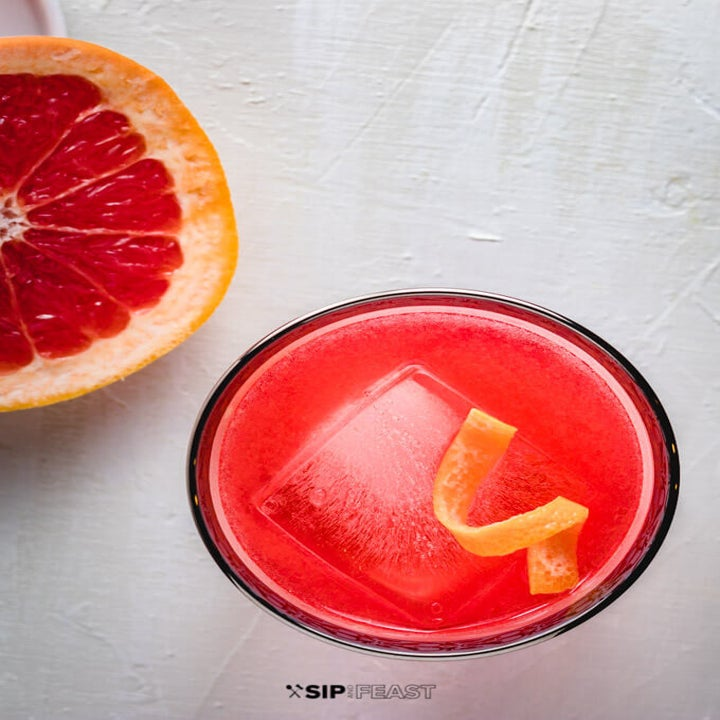 A half of a grapefruit and a grapefruit negroni.