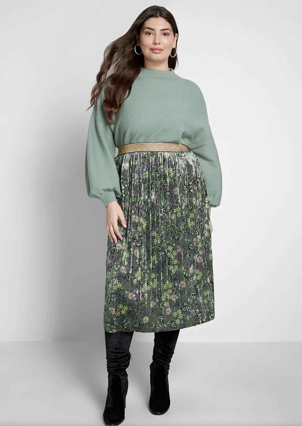 Model in green velvet pleated midi skirt with light green and purple floral detailing