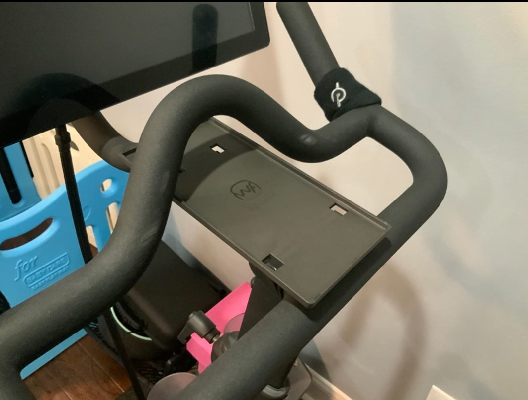 A Peloton tray for your cellphone and headphones.