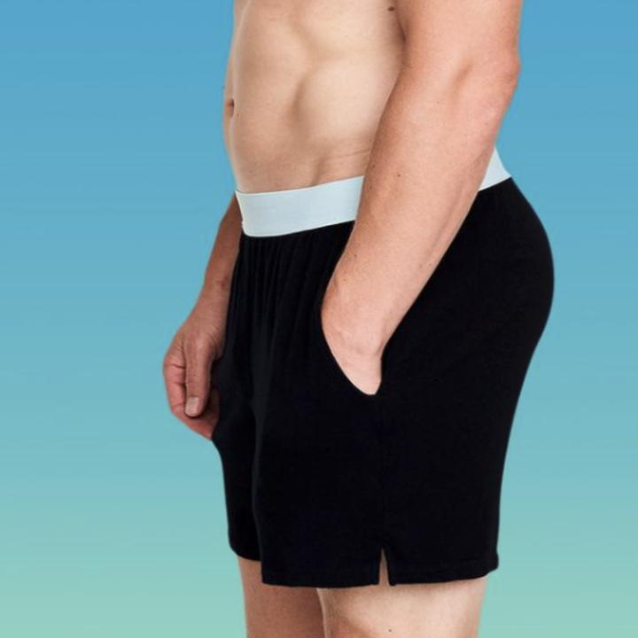 A close-up of a man wearing Jambys underwear and putting his hand in the pocket