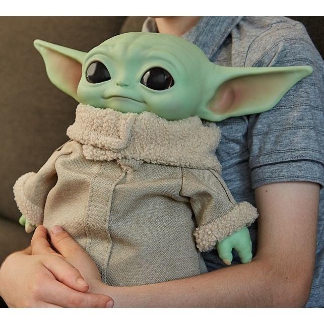 "An 11"" plush doll of Baby Yoda from The Mandalorian"