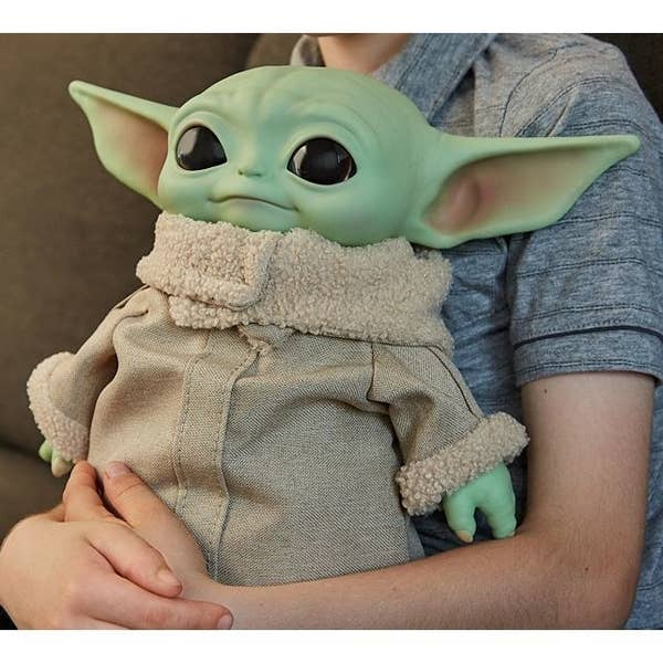 "An 11"" plush doll of Baby Yoda from The Mandalorian"