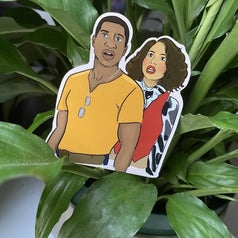 A sticker of Atticus and Leti from Lovecraft Country