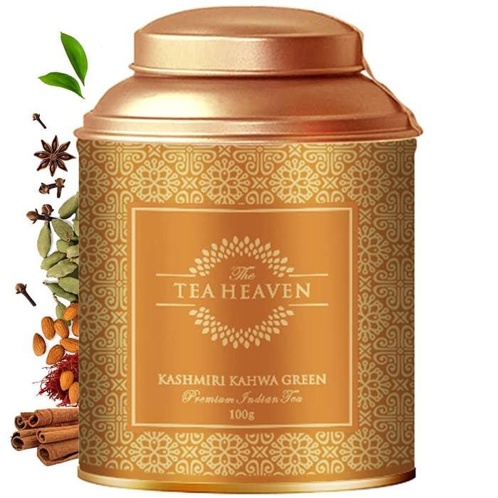 A beautiful golden tin of Kashmiri Kahwa tea with intricate design on it.