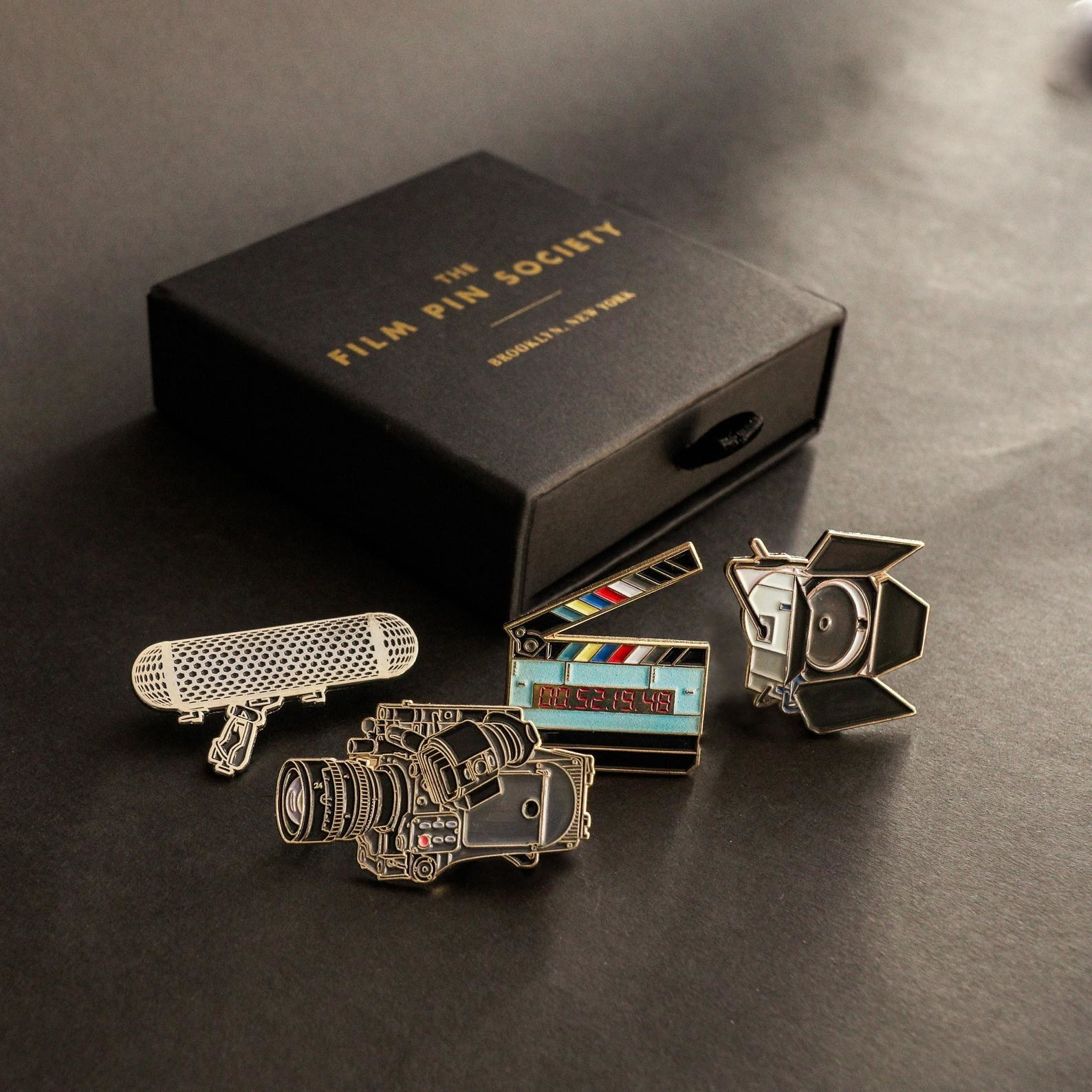 the film enamel pin set