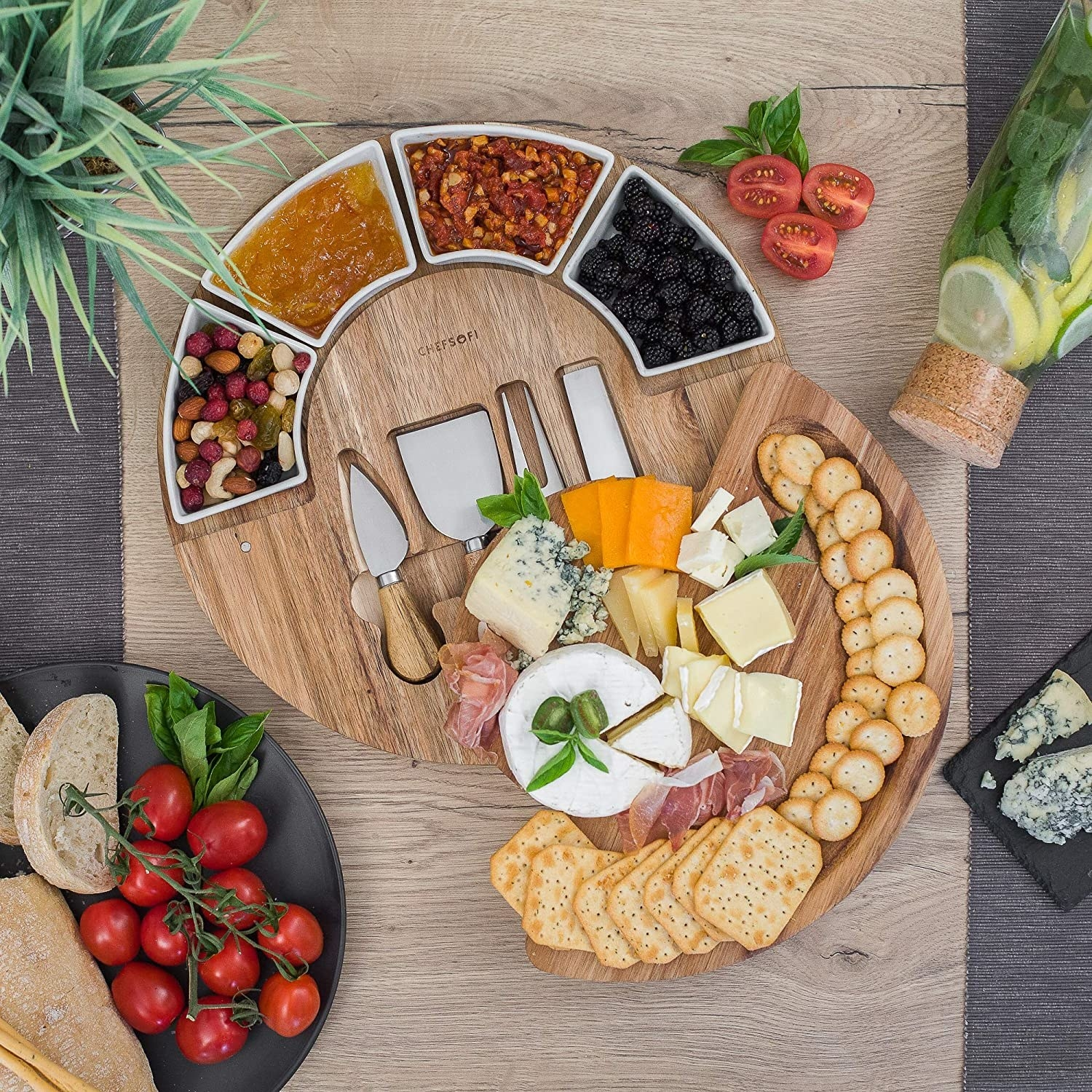 round charcuterie board with two layers that open up to provide more space
