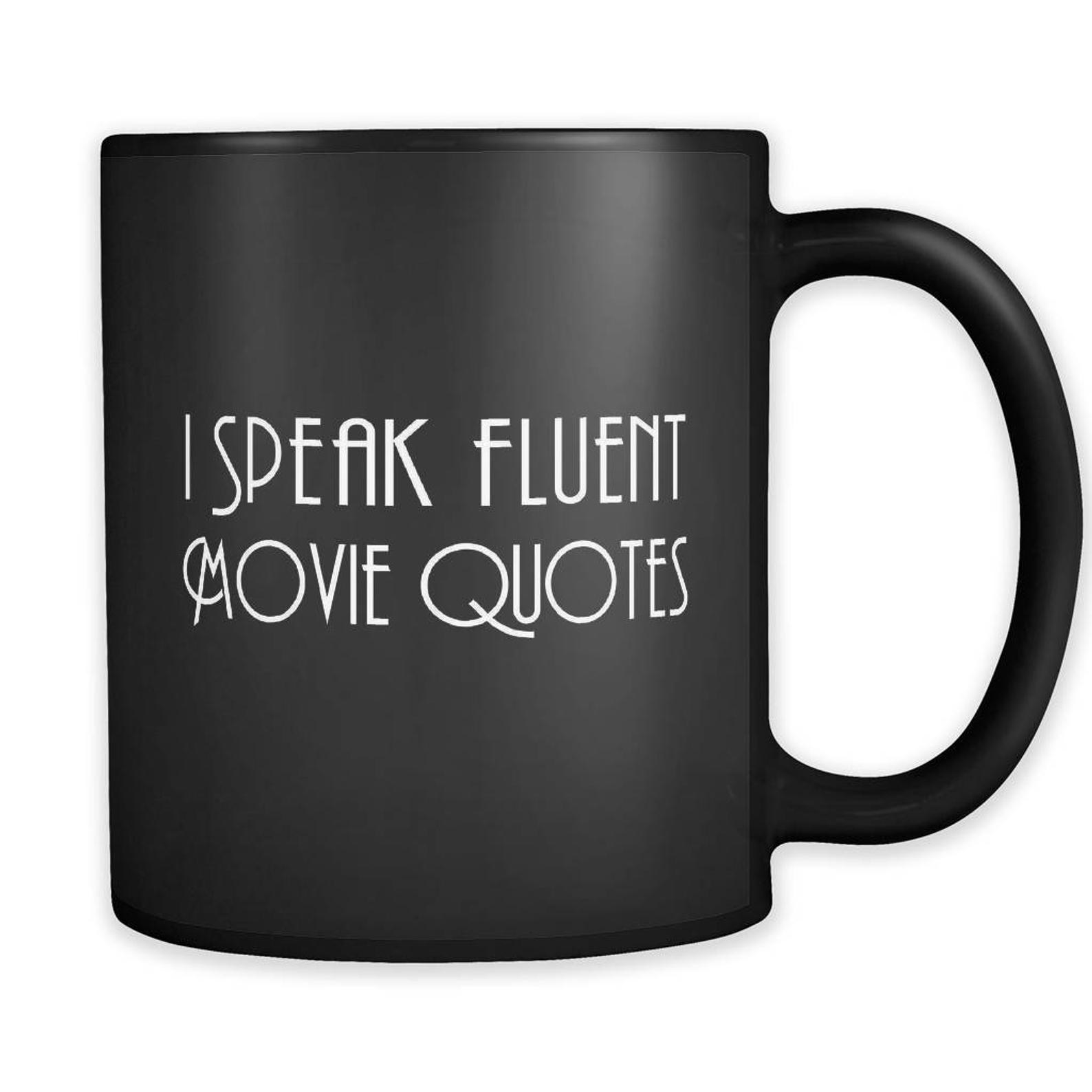 the funny mug in black that says I speak fluent movie quotes