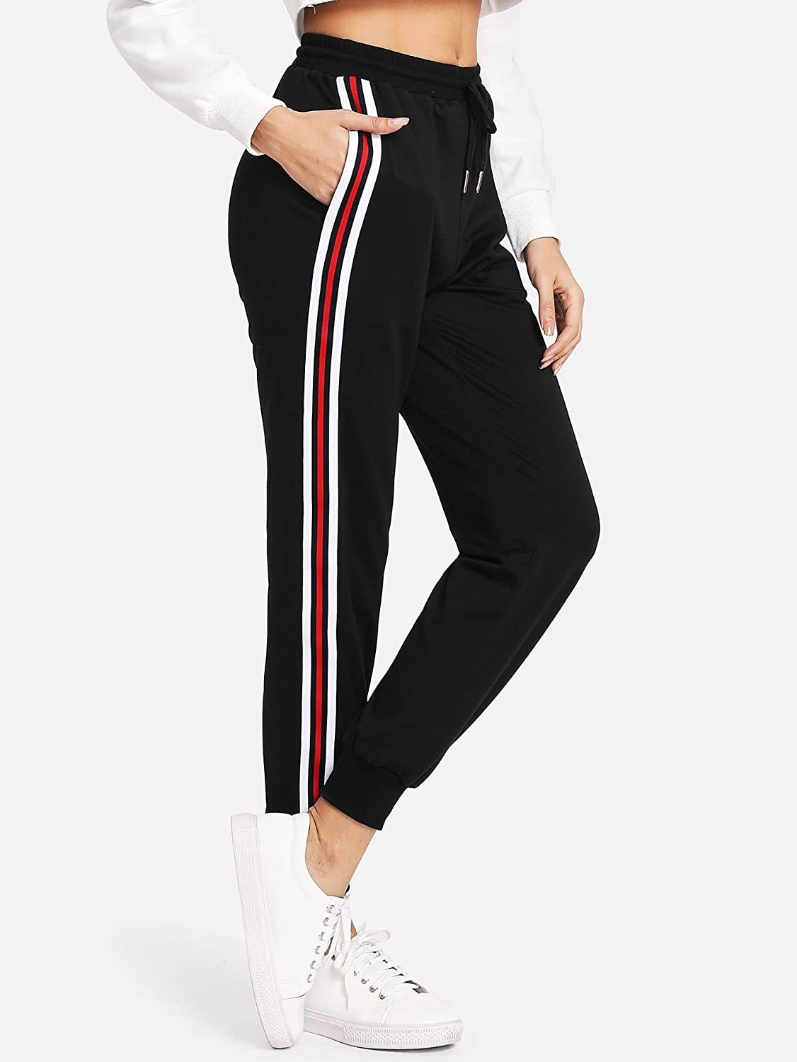 A model in the black joggers with white and red side stripes down the leg
