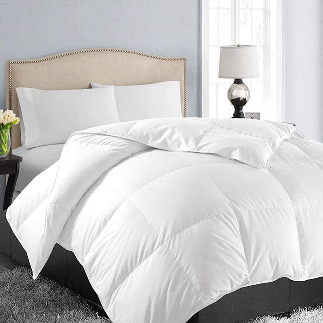 The white quilted duvet on a bed