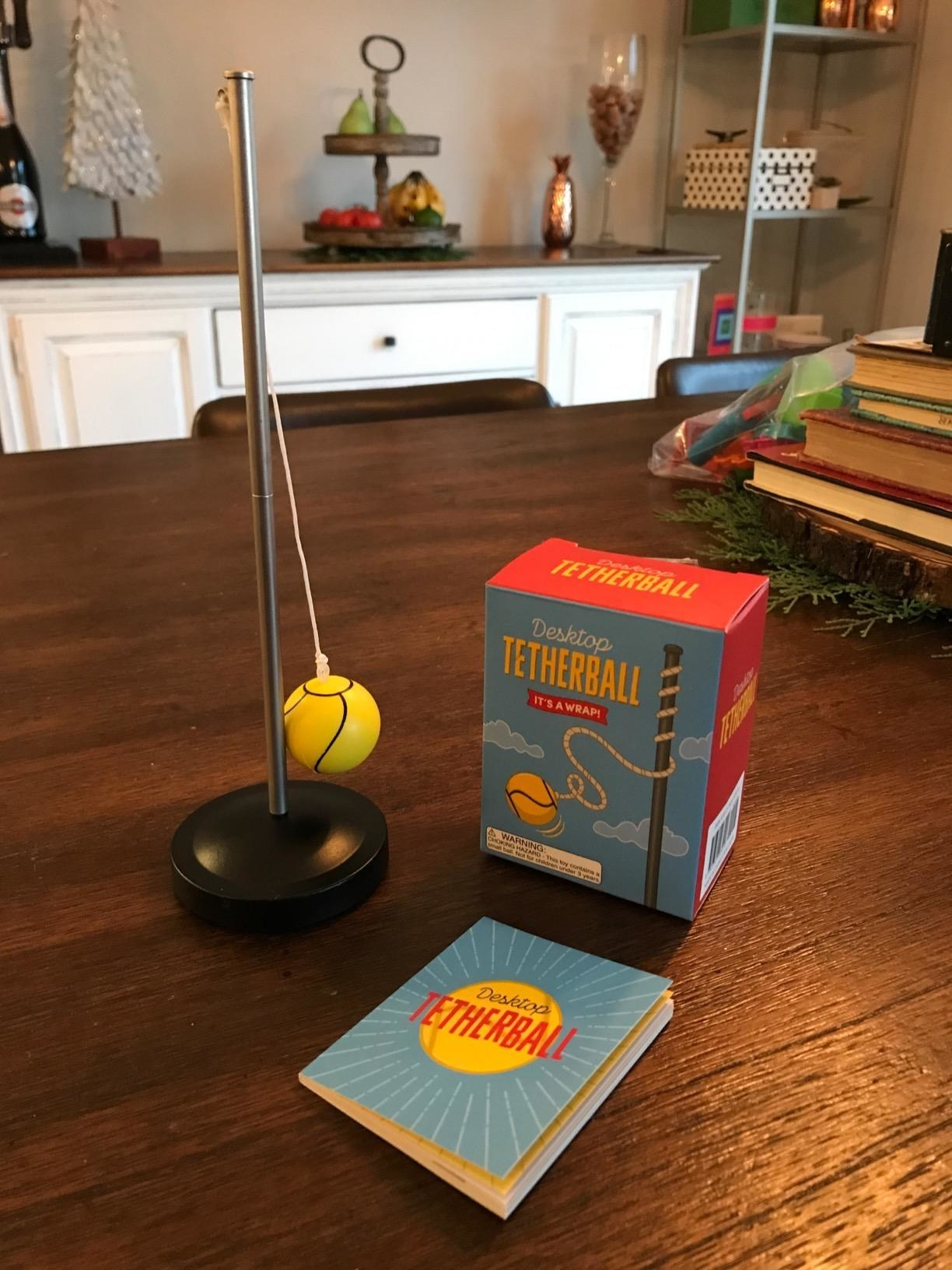 reviewer image of the desktop tetherball and booklet