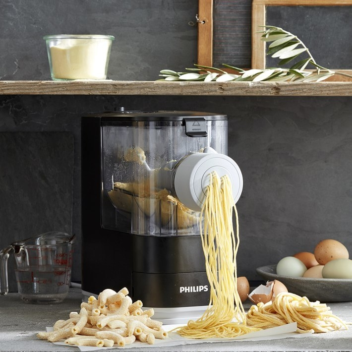 Pasta maker producing fresh spaghetti noodles