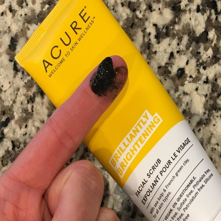 A reviewer showing the texture of the scrub